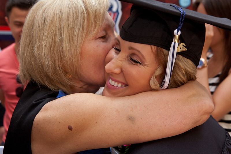 Yaryna Gogacz of Newington, CT who earned a BS in Accounting gets a hug and kiss from her mother, Maria  Pynylo after Central Connecticut State University's Commencement Exercises for the 2014 graduating class which took place at the the XL Center Saturday morning.