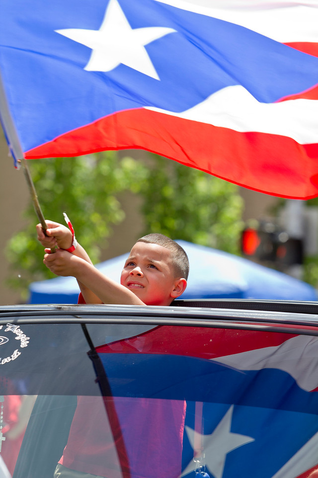 Jason Villa of Bridgeport waves the Puerto Rican flag during the annual Hartford Puerto Rican Day Parade which brought thousands into the streets of Hartford Sunday, June 1, 2014.