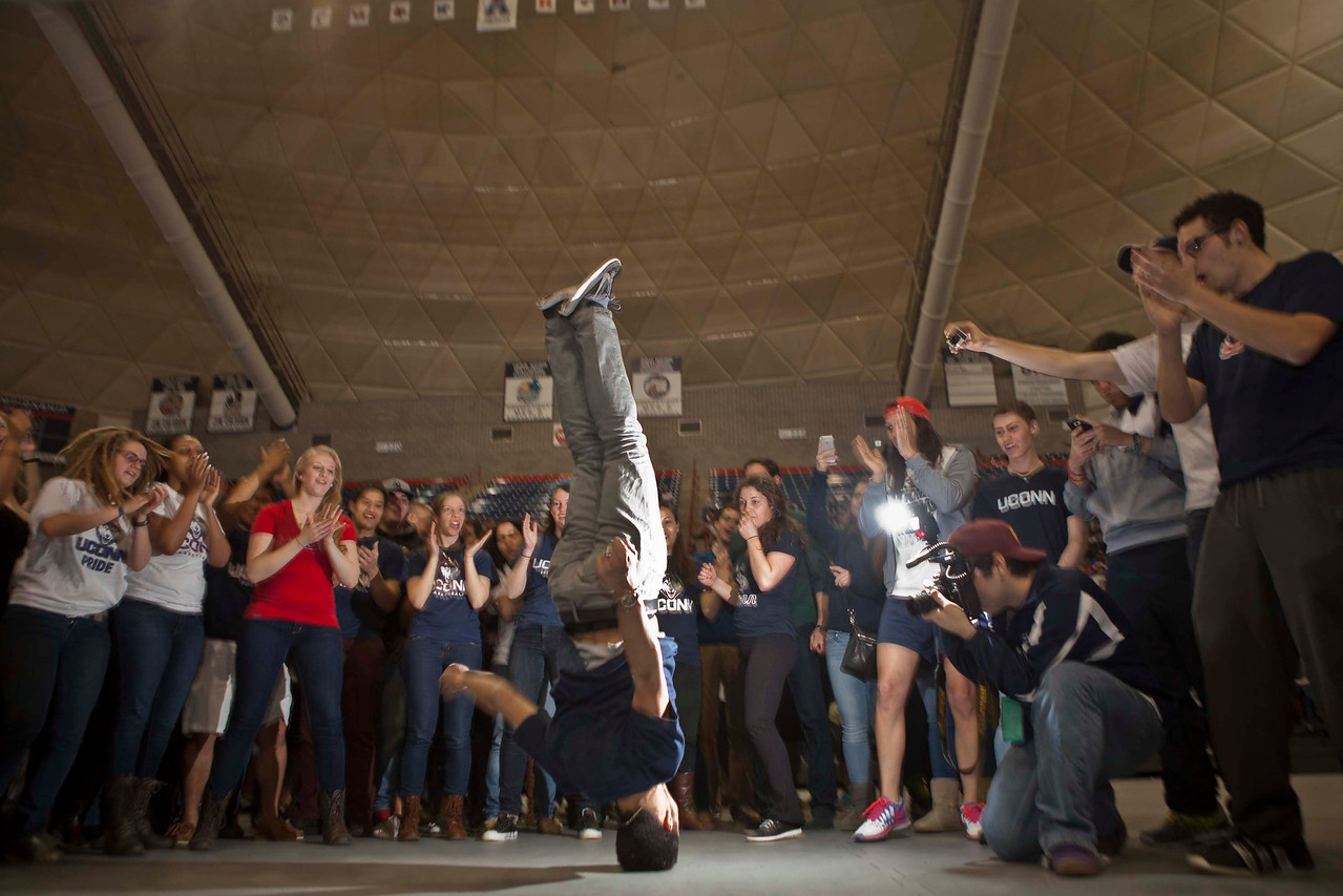 Cole McCahill, a UConn student break dances during half-time with other fans that crowded Gampel Pavilion at UConn in Storrs, CT to watch the UConn Women win NCAA Championship over Notre Dame.