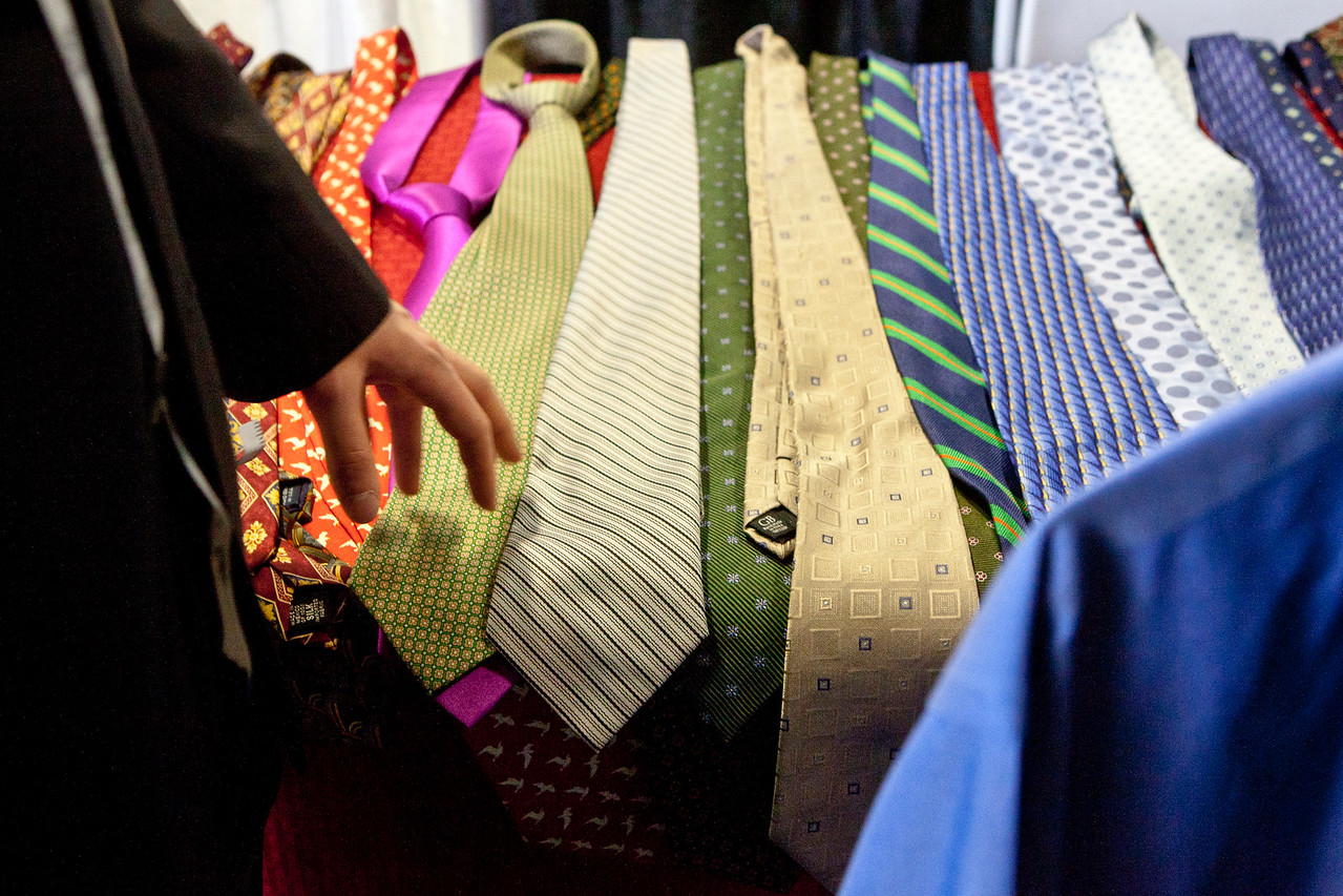 Ties lie atop a table at the Save-A-Suit area of the Hamden Chamber of Commerce job fair this Wednesday, April 15, 2015. US Veterans were encouraged to have their measurements taken and to try on suits, one of which they could take home for free.