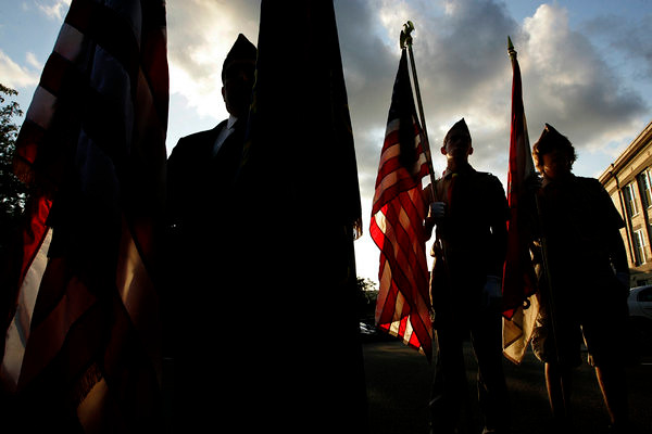 Color Guards for various organizations, left to right, Christopher Geist of the Veterans of Foreign Wars Post 73, Corbin Wolf and Alen Brinich of Troop 1 in Wallingford at the 9-11 Remberance on the front steps of Town Hall Thursday at sunset on September 11, 2008.