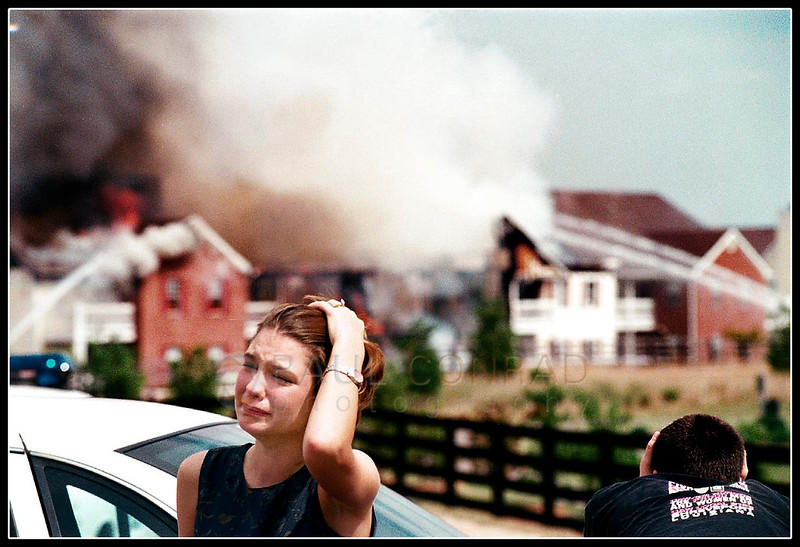 © Paul Conrad/Pablo Conrad Photography - Rachel Smith turns from a fire that is destroying her Wilkenson Trace apartment in Bowling Green, Ky., as her husband Shane watches. The newlyweds said they were horrified at the loss, yet also grateful for their lives. The fire consumed their unit including unopened wedding gifts.