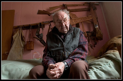 "© Paul Conrad/Pablo Conrad Photography - Pondering his next move, Lada Vrany, 87, of Aspen, Colo., sits on his bed as he describes his feelings about Pitkin County evicting him off the property he's lived on for nearly 50 years. He says he likens himself to the Native Americans in the 1800s. ""I feel like the Indians when the (U.S.) Cavalry came and kicked them off their land,"" the former construction company owner said, ""What do I do now? Where do I go and how can I move all my stuff in 30 days?"" His land will be used for expansion of the Aspen/Pitken County airport.   (© Paul Conrad/Paul Conrad Photography)"