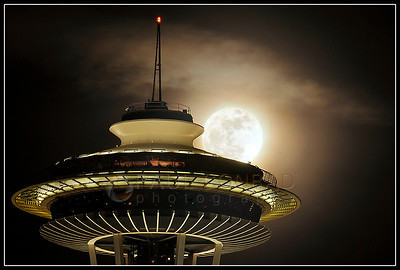 © Paul Conrad/Pablo Conrad Photography  The super perigee moon slides from behind the Space Needle in Seattle, Wash., in February 2011. A super perigee moon is larger than normal as it is closer during the full moon.   (© Paul Conrad/Paul Conrad Photography)
