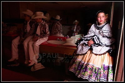 © Paul Conrad/Pablo Conrad Photography - Watching others of her dance team rehearse, Folklorico Mexicano dance team member Ashley Ventura,12, of El Jebel, Colo., watches others rehearse at Basalt Middle School while she waits for her performance during Cinco de Mayo celebrations. The Aspen Santa Fe Ballet sponsored dance troup performed througout the valley at area schools.   (© Paul Conrad/Paul Conrad Photography)