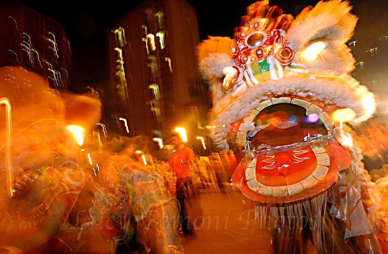 Several Lion dancers and firecrackers light up Hawaii's Chinatown during the city's the annual New Year's festival, Feb. 4, 2004 in Honolulu, Hawaii. Chinese New Year falls on Feb. 9th. REUTERS Lucy Pemoni
