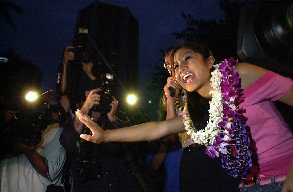 "Jasmine Trias of Mililani,  waves to fans and media surrounding her at a sunset public apperance on Waikiki Beach in Honolulu, April 14, 2004.  Trias is one of three finalists in Fox's ""American Idol .'  (AP Photo/Lucy Pemoni)"