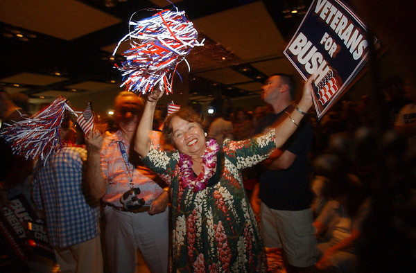 """Auntie"" Elsie Hummel of Honolulu dances and cheers prior to the arrival of vice president Dick Cheney in Honolulu, Hawaii, Sunday, Oct. 31, 2004.  Presidential polls show the usually democratic state of Hawaii to be in a dead heat. REUTERS/Lucy Pemoni"
