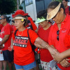 (From left) Ruby Hodges of Honolulu, holds hands with her Hula school companions friends Leolani Jackman of Honolulu and Leinohea Isaacs of Honolulu.  The women dance with Halau Ika Wekiu (Hula School). Between 8 to 10,000 thousand Hawaiians and their supporters marched down Kalakaua Avenue Sunday morning September 7, 2003 on Waikiki Beach in Honolulu during the  'Ku ika Pono' (Justice for Hawaiians) March. The protesters came from all islands to join together in a show of strenght and support for native Hawaiian political, educational and social rights.  Over 20  state and local organizations showed their support for the rally which was fueled by a recent court ruling allowing a non-Hawaiian child  to attend the prestigious Kamehameha Schools which only allow students of Hawaiian descent.  REUTERS/Lucy Pemoni