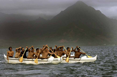 Members of the Keahiakahoe Canoe Club of Kahalu'lu paddle across Kaneohe Bay from Kuoloa Beach Park to Hale Koa Beach on Marine Corp Base Hawaii. March 6, 2004 in Kaneohe Bay. The water crossing was part of a traditional Hawaiian closing ceremony marking the end of the Makahiki season. In ancient Hawaiian tradition, the two seasons winter (Makahiki) and  the start of Summer (Ku) are regionally celebrated this time of year.  REUTERS/Lucy Pemoni