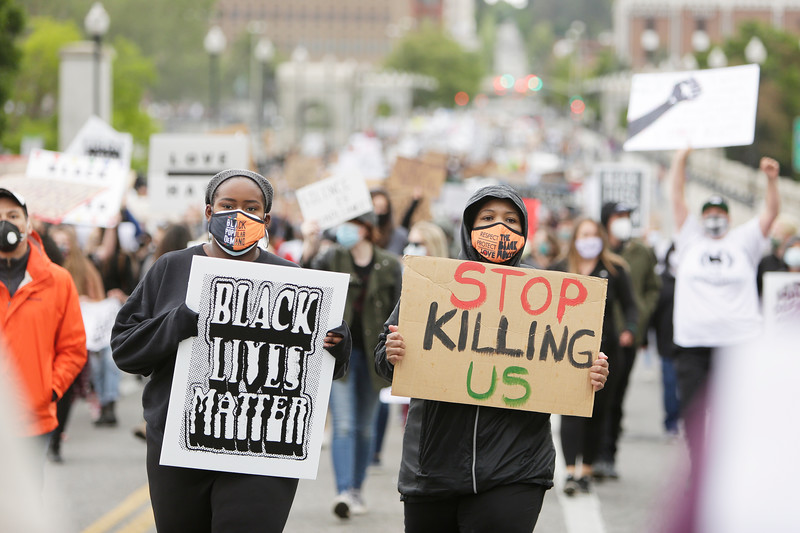 Denise Pittman, left, and Angela Hill march on N. Monroe St. during a protest against the death of Breonna Taylor, a black EMT in Louisville, Ky., who, on March 13, was shot and killed by police who were serving a no-knock warrant on her apartment, in Spokane, Wash., Sunday, June 7, 2020. This was one of many ongoing protests in the country against law enforcement committing acts of violence and killing black people. (Young Kwak/The Inlander)