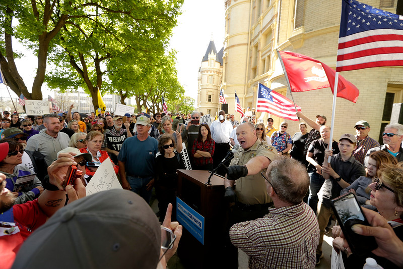 Spokane County Sheriff Ozzie Knezovich, who did not take part in the protest, addresses protesters after a demonstration against the state's stay-at-home order to help slow the spread of coronavirus disease (COVID-19) in front of the county courthouse in Spokane, Washington, U.S. May 1, 2020. REUTERS/Young Kwak