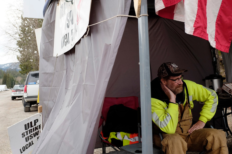 Miner Rick Norman speaks with Inlander Staff Writer Samantha Wohlfeil, not pictured, at a picket line during a strike in front of the Lucky Friday mine in Mullan, Idaho, Friday, April 14, 2017. Employees who are members of United Steelworkers Local 5114 have been on strike since March 13 at the Lucky Friday mine after they were unable to come to a new collective bargaining agreement with Hecla Mining, the company that owns the mine. The company and the union could not come to an agreement mainly about pay, benefits and scheduling. (Young Kwak/The Inlander)