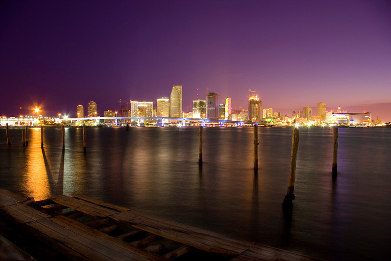 Reflections of downtown Miami at dusk. This photo was taken overlooking an old pier slowly being reclaimed by the sea.