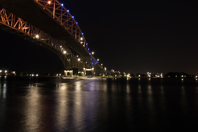 Night image of the Blue Water Bridge from Port Huron crossing over the St. Clare River overlooking Sarnia Ontario Canada