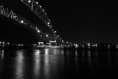 B&W Night image of the Blue Water Bridge from Port Huron crossing over the St. Clare River overlooking Sarnia Ontario Canada