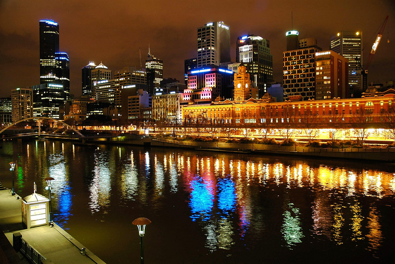 Flinders Street Station seen across the Yarra river in Melbourne, Victoria, Australia.<br /> This image is taken from the Princess Bridge. One the left is the Southgate and the Southbank Promenade.