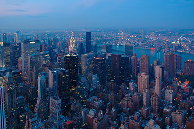 A panoramic view of NY as seen from the viewing gallery on top of the Empire State Building in the Big Apple, New York, USA. Aug 2004