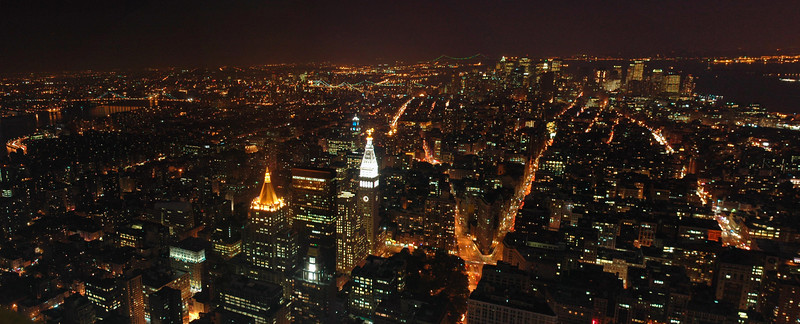 View of New York City at night from Empire State Building, NYC, NY, USA.