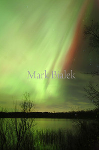 11/8/04 - The Northern Lights streak over Wolf Lake in Oshtemo early Monday morning.  The lights stretched across the entire sky at times Sunday night and Monday morning.    This turned out to be a major event throughout the entire midwest.  The Free Press centerpieced it.