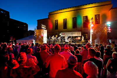 The Ann Arbor Summer Festival, also known as Top of the Park, is in full swing with red lights shining on the crowd at dusk.