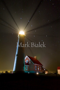 The lighthouse in Tawas Michigan on a foggy night.
