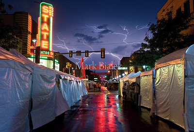Lightning splinters across the sky after a rainstorm at the Ann Arbor Art Fair.