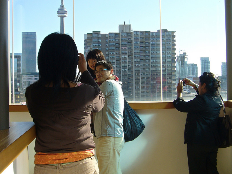 New immigrants in front of the CN Tower, AGO, Toronto (2010) © Copyrights Michel Botman Photography