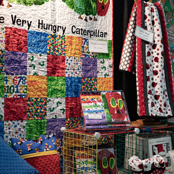Quilts on display at the booth for The Quilt House