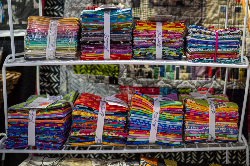 Packages of Fat Quarters by at the Private Source Quilting booth