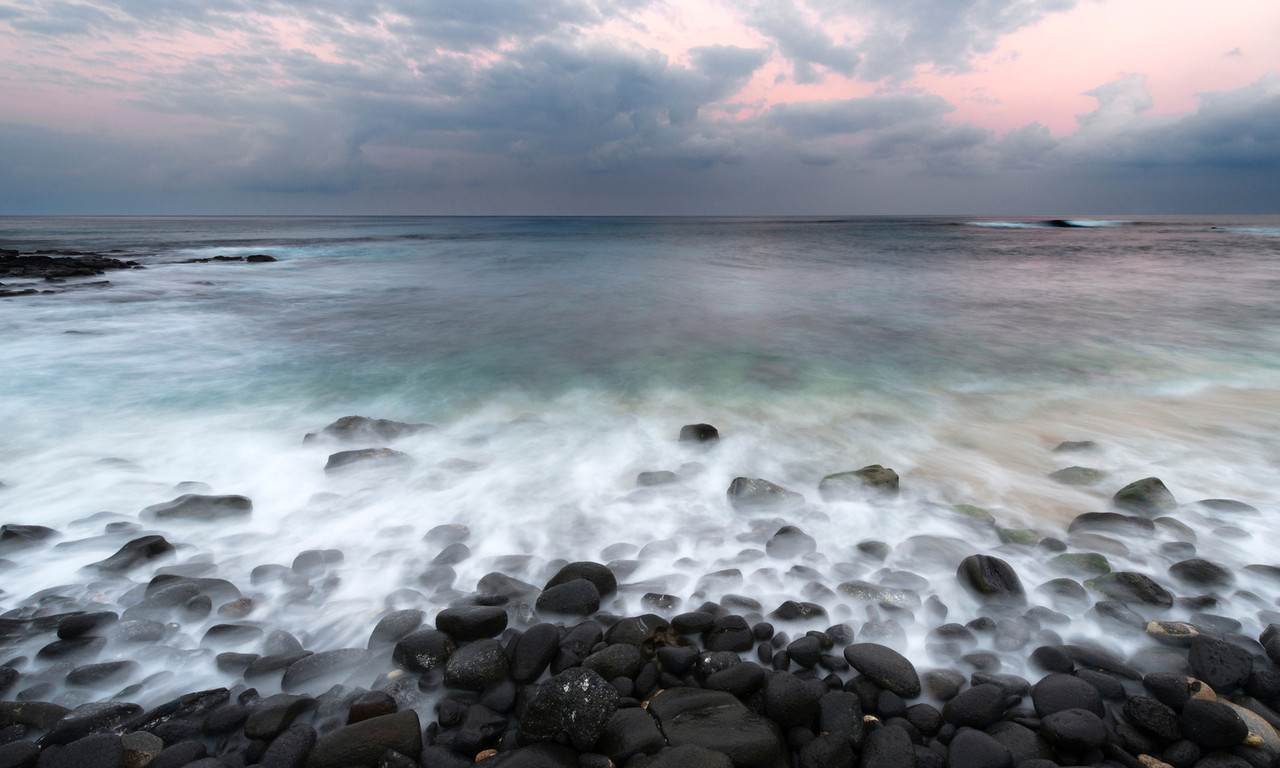 Whispering Stones, Kona Coast - Hawaii<br /> <br /> With a long exposure, the movement of the waves creates a ghostly mist around the water-rounded black lava rocks of the Kona Coast.