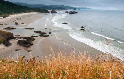 """Crescent Beach - Oregon  The small town of Cannon Beach, with its iconic """"Haystack Rock"""", as seen from Ecola Point, just north of the city."""