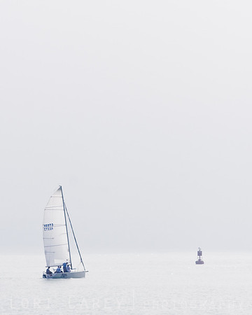 "Sailboat ""Blitz"" navigating the channel at Dana Point Harbor in the fog."