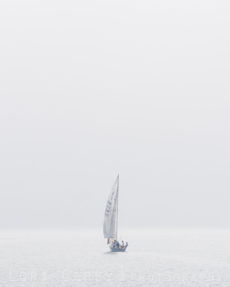 Sailboat in fog, Dana Point, California