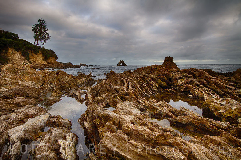 Moody skies over the Robert E Badham Marine Life Refuge tidepools at Little Corona Beach, Corona del Mar, California