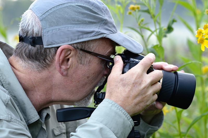 Photographer taking a macro shot at the Ironweed Field