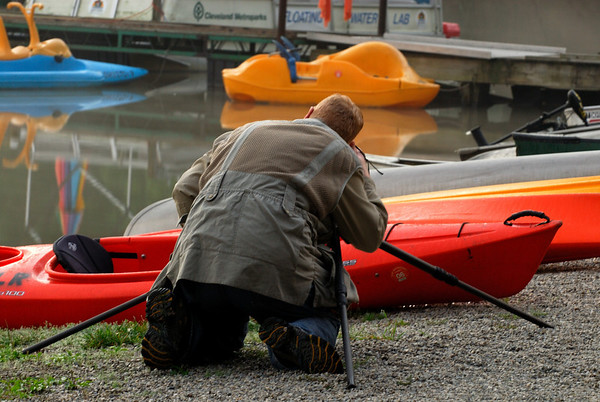 Ed photographing a row of kayaks