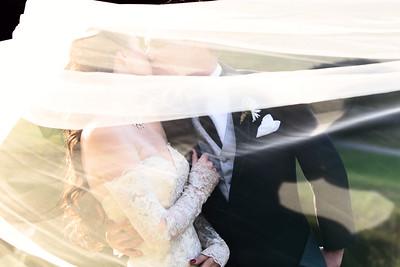 Bride and Groom behind veil at the homestead | Rayan Anastor Photography | Glen Arbor MI Wedding Photographer