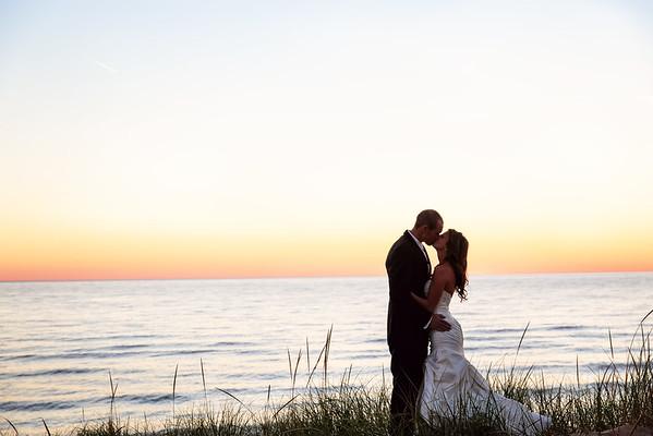 Muskegon Bride and Groom at Sunset on Lake Michigan | Rayan Anastor Photography | Muskegon Wedding Photographer