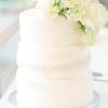 White wedding cake and flowers  | Rayan Anastor Photography | Traverse City Wedding Photographer