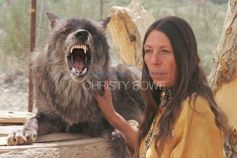 9/9/99<br /> Wolf Mountain Sanctuary<br /> Lucerne Valley California<br /> <br /> Tonya Littlewolf Carloni shares a pensive moment with one of her favorite wolves- Dakota, a British Columbian Black Wolf.<br /> <br /> photo by Christy Bowe / ImageCatcher News / PHOTOlink