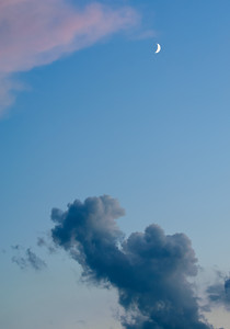 Moon in Sky at Sunset with dark cloud