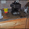Coffee, grounds, and broken glass all over the kitchen - The Exploding Mr. Coffee Espresso Maker - A mess to clean up - glass shards and coffee grounds were all over the kitchen!