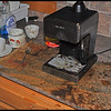 The mess after the explosion - The Exploding Mr. Coffee Espresso Maker - A mess to clean up - glass shards and coffee grounds were all over the kitchen!  We had to throw away the sugar in the sugar bowl, all the cat food in the nearby cat dishes, and spent an hour cleaning everything up.