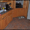 Overview of the Scene - The Exploding Mr. Coffee Espresso Maker - A mess to clean up - glass shards and coffee grounds were all over the kitchen!  The cabinet doors and drawers were all speckled with coffee debris, as was the refrigerator and cat food bowls on the floor.