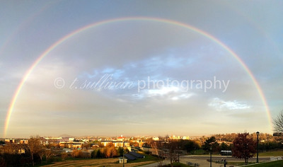 Large rainbow over James Madison University campus