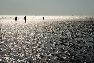 3 Menschen am Strand