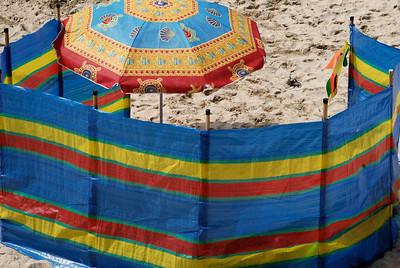 Sonnenschirm und Windschutz