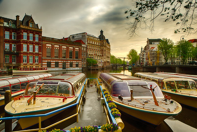 Riverboats along a canal, Amsterdam