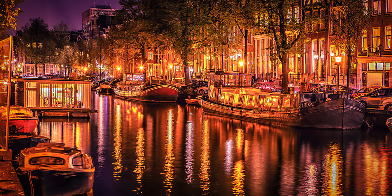 RIverboats along a canal at sunset, Amsterdam
